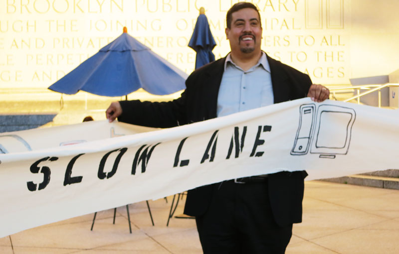 "Joe Torres participates in ""Fast Lane/Slow Lane"" political theater in Brooklyn on Monday, October 27, 2014."