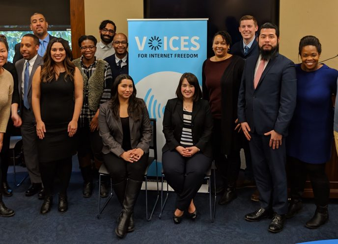 Voices for Internet Freedom coalition members pose in front of a banner