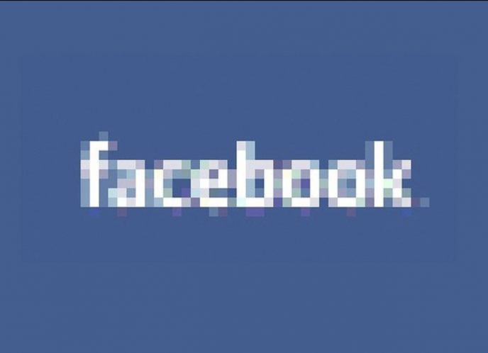 The Facebook logo, blurred out.