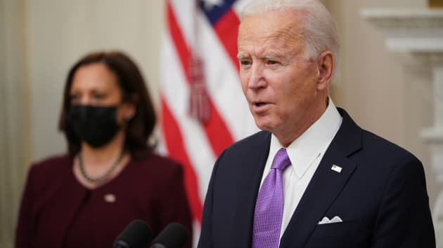 US President Joe Biden speaks about the Covid-19 response as US Vice President Kamala Harris (L) looks on before signing executive orders in the State Dining Room of the White House in Washington, DC, on January 21, 2021. Mandel Ngan | AFP | Getty Images