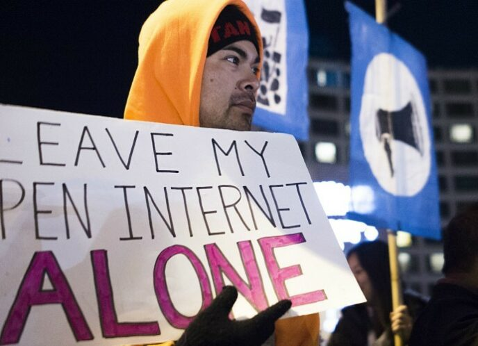 A group of open internet advocates protest then-FCC chair Ajit Pai's net neutrality repeal plan during a demonstration on December 7, 2017 in Washington, D.C. (Photo: Andrew Caballero-Reynolds/AFP/Getty Images)