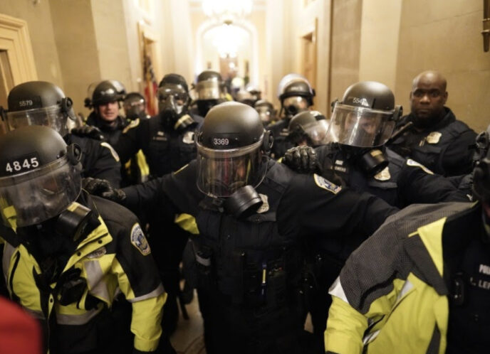 Riot police clear a hallway in the Capitol on Jan. 6. (Kent Nishimura / Los Angeles Times)